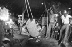 The Suke Jimenez family in their dirt-floored hut in 1986. Once migrant laborers during summer months and squatters in the winter, the Kickapoos' fortune rose dramatically with the arrival of gambling.