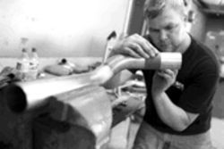 Tracy Litton forms a stainless steel tailpipe.