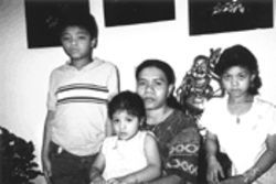 Thu Phuong Thi Nguyen, shown here with children Tony, Julia and Julie, may soon be a single mom if husband Lai My Truong is deported to Vietnam.