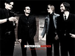 Bright lights, dark suits: Interpol