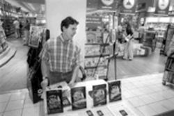 Frank Thomas hawks his POD book, Madre de Dios, at B Dalton Books at Town East Mall. Two hours of hustling netted him seven sales.