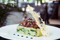 The shredded beef with avocado risotto goes vertical like much of Manuel's menu.