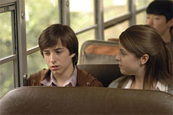 Cheer up, kid (Reece Daniel Thompson), at least the cute girl (Lisbeth Bartlett) is sitting next to you.