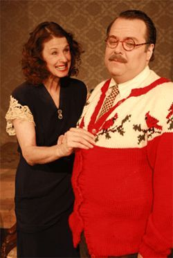 Adolph Freitag (Randy Pearlman) pretends to like the holiday sweater knitted for him by his sister-in-law Reba (Cindee Mayfield) in The Last Night of Ballyhoo.