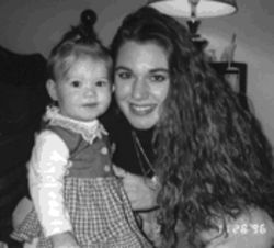 Kelli Cox and her daughter, Alexis Raulston: The child was 11 months old when this photograph was taken and is now 5 years old. One reason Cox's disappearance was immediately considered suspicious is because she would have never abandoned the baby, Cox's mother says.