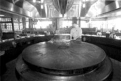 BD's giant griddle supposedly mimics shields once used as cookware by Mongolian warriors, though we bet they didn't wear gimme gaps.