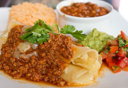 Monica Greene may not love Tex-Mex, but she has perfected enchiladas with chile con carne.