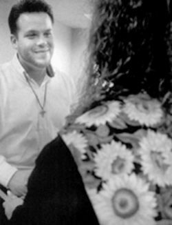 Randy Thomas chats with a woman disturbed by the long, passionate kiss she shared with another woman. Thomas prayed for the woman, who doesn't want to be involved in homosexuality, during a June singles seminar at Prestonwood Baptist Church in Plano.