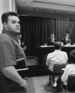 Thomas listens while a panel of Southern Baptists discusses the denomination's prohibitive stance on gays and the ordination of women. Thomas traveled to the recent Southern Baptist Convention in Orlando to counter protests by Mel White, an evangelical who says he's made peace with his gayness.