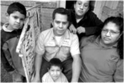 Explain this to your kids: Jesus and Maria Mejia with their children, Jesus, David and Yesenia (from left to right)