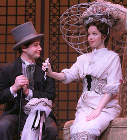 Daniel R. Johnson, as Freddy, stalks Kimberly Whalen's Eliza on the street where she lives in Lyric Stage's My Fair Lady.
