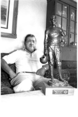 Bill Thorpe, shown here with a statue of his famous father, Jim, in Arlington, wants his dad's body returned to Oklahoma for proper burial.