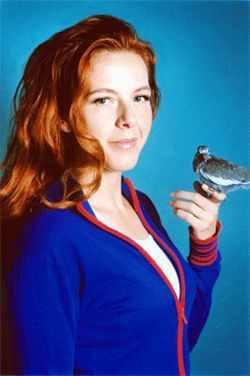 Maybe, sparrow: Neko Case poses with a fellow songbird  before doing her Brian Fellows impersonation.