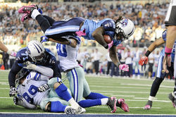 Before Titans running back Chris Johnson (airborne) got all Terrell Owens-offensive in his celebration, he scored this touchdown, and another before that.