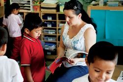 Teacher Emma Hernandez helps Melvin Utuy while newcomer Adrian Bautista works quietly on his own.