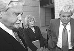 Shelton and her attorneys Randy Taylor, left, and Jerry Cobb outside the Denton County courts building after an appearance relating to a stalking charge filed against Shelton by former associate William Parker