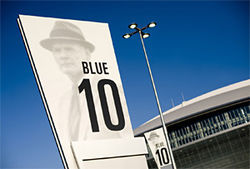Parking lot signs at Cowboys Stadium bear the image of Tom Landry, but what would the introverted former coach think of Jones' opulent palace?