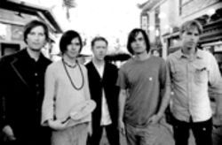 Brian Jonestown Massacre, led by Anton Newcombe, second from right, might knock you out on Saturday night...with a kick to the face.