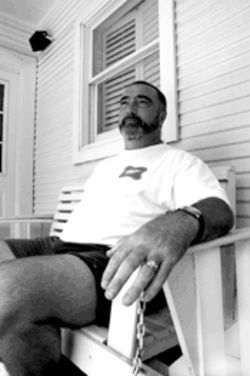Carmichael sits on the back porch of Thee Hubbell House. He now plans to sell the bed and breakfast.