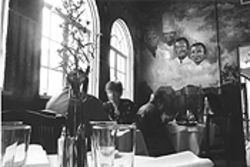 A quartet of great chefs overlooks Le Paris Bistrot's dining room.