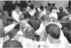 Inmates near Houston join in prayer as part of InnerChange Freedom Initiative's prison ministry.