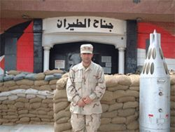Kirkuki in front of the base's command post building in Iraq.