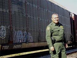 Jorge Diaz, a naturalized citizen from a family of migrant farm workers, checks trains north of Laredo for illegal immigrants. He was born in Mexico, but his loyalties to the United States are clear.