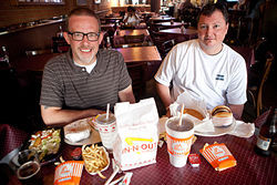 Grape owner Brian Luscher (left) and Angry Dog owner Todd Dickerson compare Whataburger and In-N-Out.