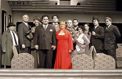 Producer Barbara Weinberger (center) wears red in curtain calls for Death Express! in contrast to the black and white costumes, set and makeup.