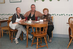 Humorist, waiter and restaurateur Mark Petryk, flanked by wife Lori, left, and their neighbor, Ruth Beard. Damn, those Mennonites are friendly.