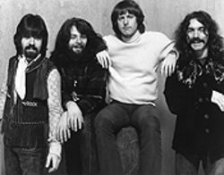 "The Byrds in December 1969, from left: Clarence White, Skip Battin, Roger McGuinn, and Gene Parsons. White -- ""an unsung hero,"" says McGuinn -- died four years later."