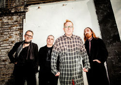 Lydon (center) and the new PiL