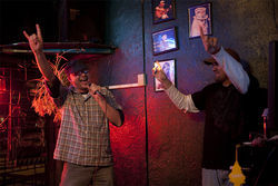 Customer Anthony Muelle rocks out during a karaoke night at The Winedale Tavern.