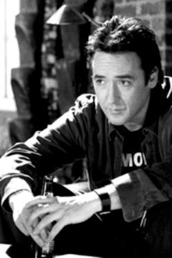 His bark is worse than his bite: John Cusack has a cold nose and warm heart (yuck) in this doggy date movie.