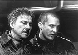 Ham subs: Harvey Keitel (left) undertakes an impossible military task -- to keep sub-mate Matthew McConaughey (right) clothed and away from bongo drums.