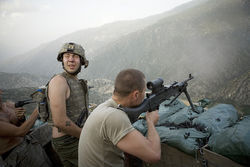 Specialist Misha Pemble-Belkin and fellow soldiers during a firefight at Outpost Restrepo in Afghanistan.