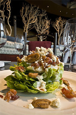 "The Bibb salad, usually a steakhouse cliché, at Blue Canyon is a ""turn of brilliance"" with its spiced nuts, chewy bacon and murky blue cheese."