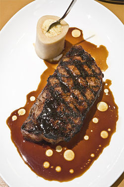 Then there is steak: A dry-aged New York sirloin in a lithe Cabernet reduction with marrow flan.