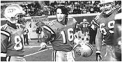 First and...whoa: Keanu Reeves isn't the one, playing a reluctant QB.