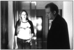 Leelee Sobieski and Stellan Skarsgård prowl around a haunted, but not scary, House.