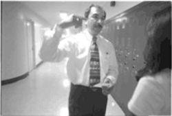 Sunset High School Principal Daniel Menchaca checks a hall pass while making the rounds at his mostly Hispanic school: &quot;We have to struggle to get every little thing we&#039;ve got,&quot; he says.