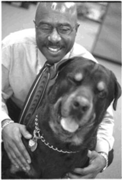 Pictured with his dog Justice, Lancaster City Councilman Vic Buchanon says the school system has given diversity short shrift.
