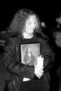 A tragic end: A fan clutches a photo     of Dimebag.