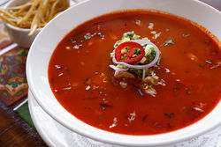 Guajillo chiles give Soleo's pozole a rusty red color and earthy flavor.