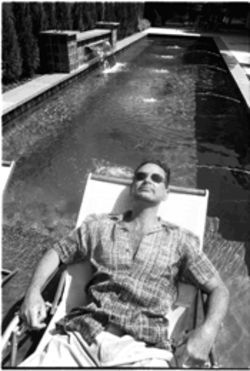 Stephan Pyles relaxes at his swimming pool. It's been a long, strange trip from hot, dry Big Spring, Texas, to the top of the food chain.