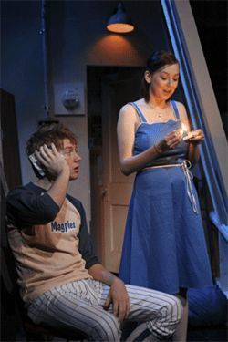 Micah Pediford (Harlon) and Sara Menix (Frannie) share an ear-piercing moment in Stanton's Garage.