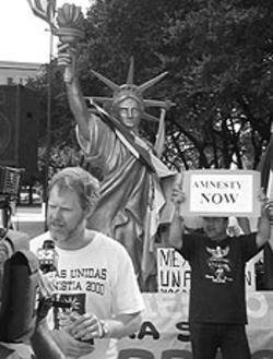 Paul Kerr, director of the Center for Human Rights in Dallas, gives a television interview at a rally for amnesty on the Fourth of July.