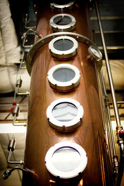 A copper still (top) towers inside the Ranger Creek Distillery in San Antonio.