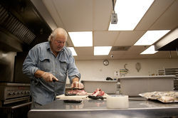 Al Marcus, who prepares his cured pork products in a certified kitchen in the Heights in Houston, doesn't see the need for a Cottage Food Bill.