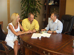 Karen and Lance Morris meet with lawyer Jeff Raizner, whose firm isrepresenting Lance, a former Justin volunteer firefighter, over a claim that Texas Mutual acted in bad faith in denying coverage for Morris' back injury.